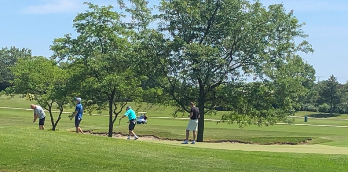 2019 Golf Outing photo of 4 golfers on the links