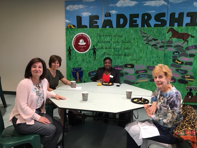 Four ladies, including EPCC President Nicki Seidl, enjoy a networking breakfast at EP Community High School on May 17, 2018