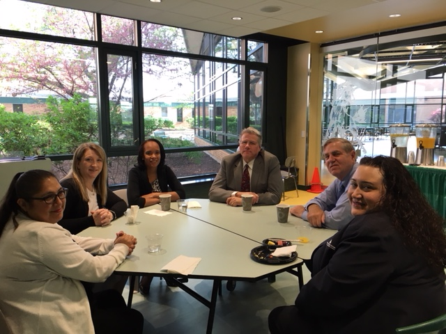 A table full of Evergreen Park Chamber of Commerce members enjoy a networking breakfast at EP Community High School on May 17, 2018