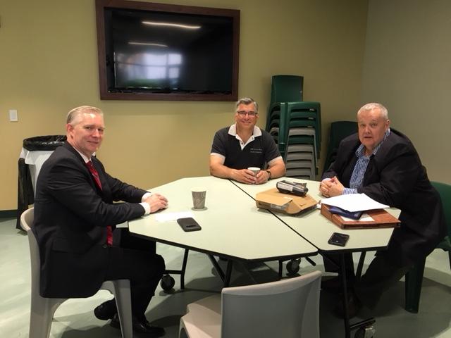 Three gentlemen enjoy the EPCC's networking breakfast at EP Community High School on May 17, 2018