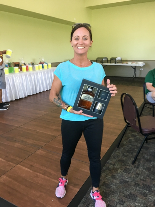 2019 Golf Outing photo of guest with silent auction prize