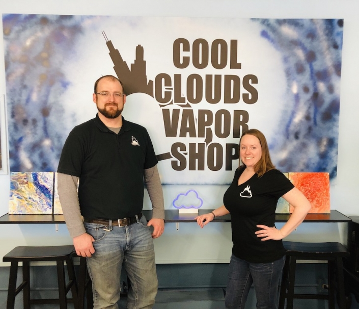 Cool Clouds Vapor Shop owners pose in front of store sign