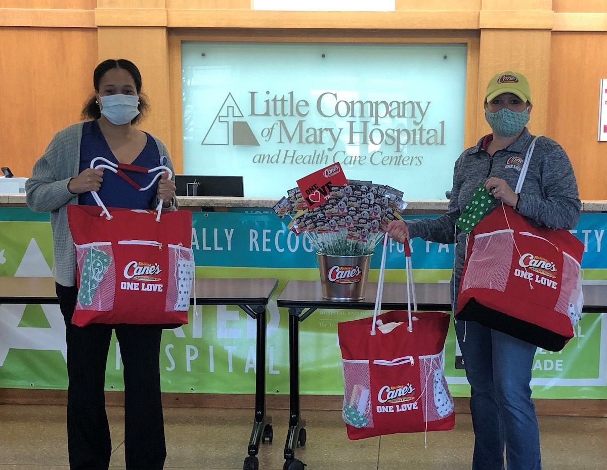 Healthcare workers at OSF Healthcare Little Company of Mary Hospital receive face masks made by the employees at Raising Cane's