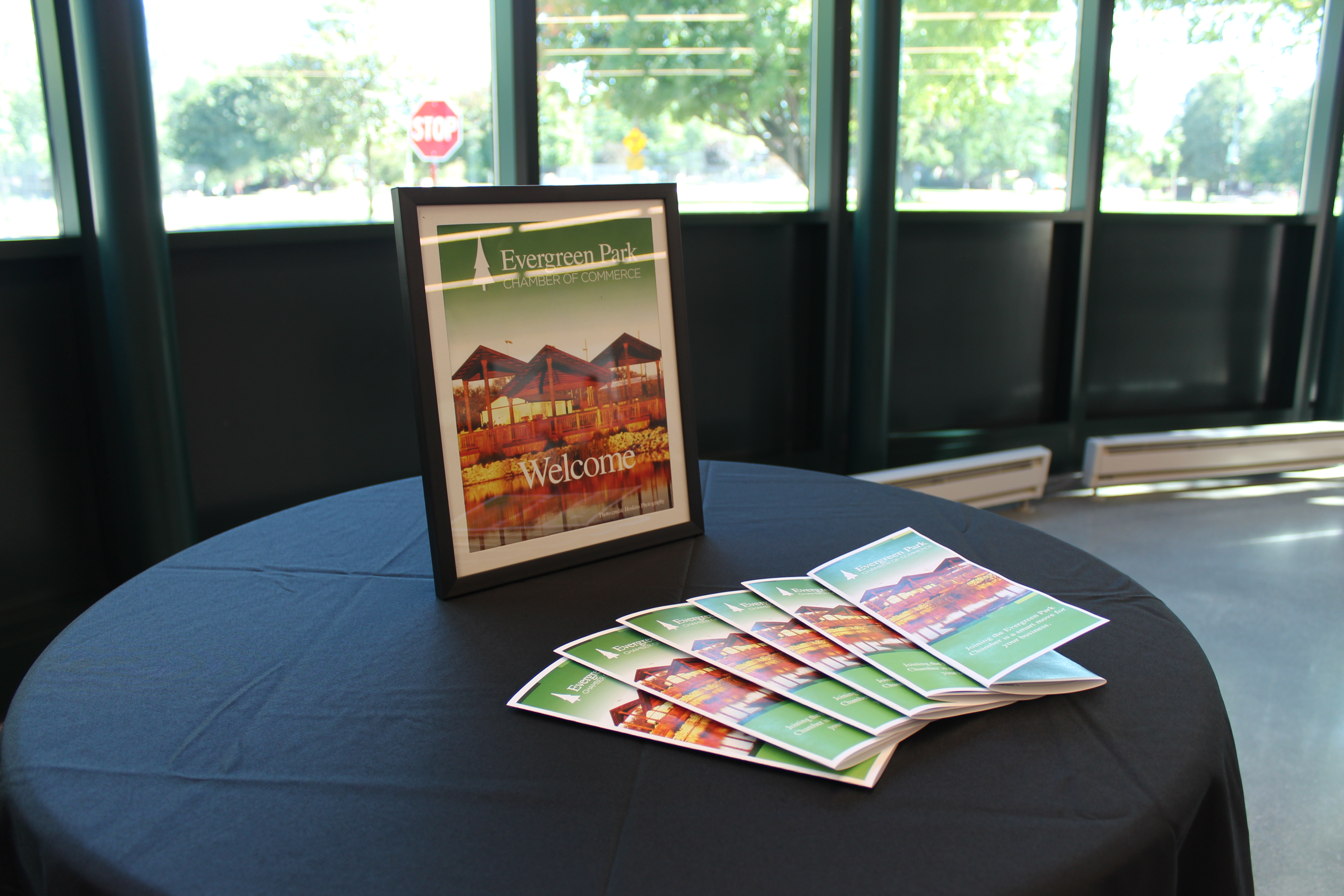 Table with Evergreen Park Chamber of Commerce membership pamphlets and Welcome sign