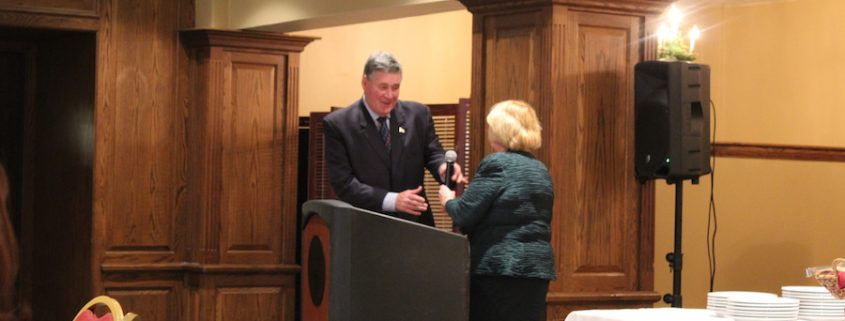 Evergreen Park Mayor James Sexton receives the 2017 Citizen of the Year Award from the Evergreen Park Chamber of Commerce at Beverly Country Club on December 13, 2017.
