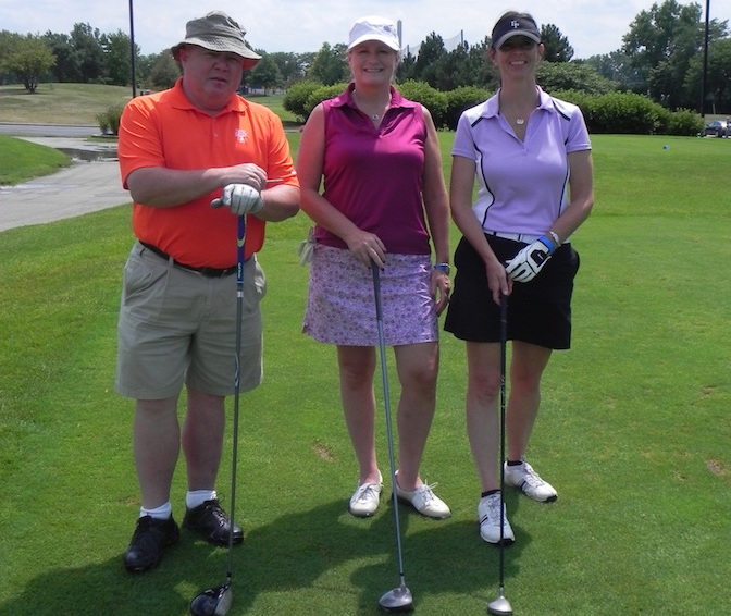 SXU threesome on putting green at Evergreen Park Chamber Golf Event